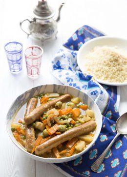 Couscous printaniers aux saucisses végétales, olives et citron confit
